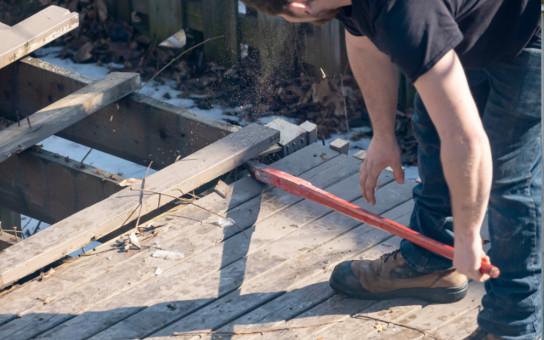 Technician Demolishing the Deck in Oakville Region